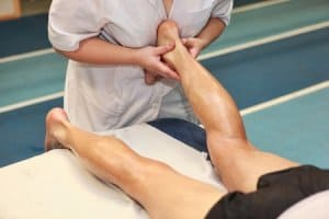 picture of doctor massaging achilles tendon