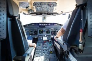 image of cockpit with pilot with knee pain